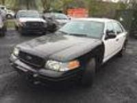 BLACK AND WHITE POLICE CAR,Ford Crown Vic