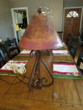 Very heavy iron lamp. Shade is also metal.