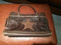 Used still lots of life100% leather tooled super large purse with star western purse needs some leather cream but overall great shape