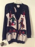 NAVY SWEATER with ICE SKATERS by SUSAN BRISTOL. SIZE LARGE