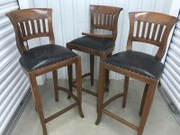 3 Teak wooden barstools with leather seats
