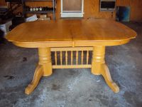 Solid wood table with two leaves