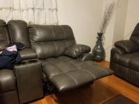 Gray leather recliner and love seat