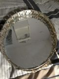 vintage round mirror with gold colored trim