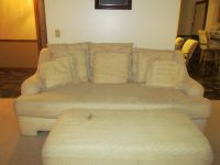 White sofa, loveseat and ottoman