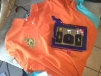 baby blue and orange polo shirts with the polo calogne