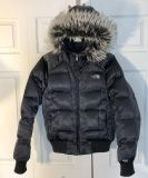 The North Face woman s Gotham 550 goose down filled winter coat with removable fur hood, size med, metallic charcoal color! Excell cond.
