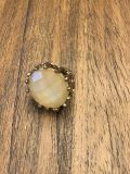 Beautiful ring with stretchy band. Soft yellow gem stone matches all! very eye catching