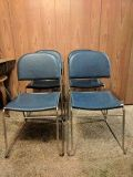 Four Metal Blue Cushioned Chairs