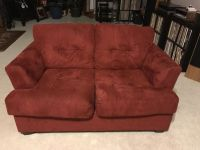 Red suede love seat