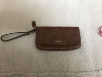 Coach wristlet/clutch in perfect shape. Used one time. Approx 8.75 x 5 . $35