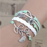 Teal owl and bird leather type adjustable clasp bracelet NEW!