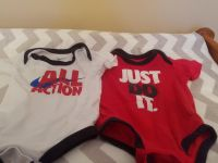 Size three months Nike onesies. Great condition.