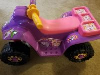 Girls, kids little ride on toy, has button to make it go