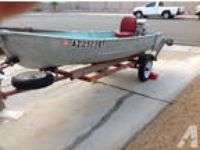 Aluminum boat with Johnson motor and trailer -