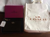 New with tag. Coach wristlet.