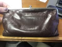 Hobo wallet. Brown leather. Well loved but life left.