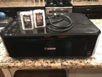 Canon printer with two brand new ink cartridges (one color, one black). Works great. Prints and copies. Wireless.