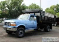 Ford F SD Ft. Flatbed Dump Truck