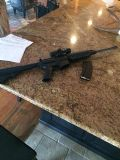 $1,400, DPMS AR 15 w red dot $1400