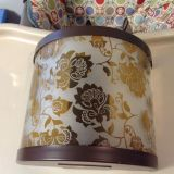 """EUC tea light candle wall sconce. Colors of brown and golden color. Approximately 10"""" tall."""