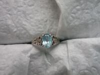 Sterling silver ring about 7.5, blue stone aquamarine?