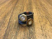 Super cute ring with leather bands with two tone gems
