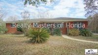 Over 2 ACRES~ Fenced yard ~ 4 bedroom 2 bathroom ~ Pet friendly~ Available SOON!!