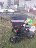 grey black red jogging stroller