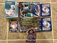 GUC Pok mon card set: trading album, large EX and small GX card and 25 additional cards