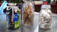 Large sized antique mason jars with sea shells and clothes pins accent display decor