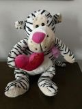 11 Black/White Plush Tiger with pink ribbon bow at neckline and pink heart that says Hug Me and has two red hearts on it.