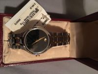 NIB-Exquisite Movado watch-black face with diamond at 12-gold and platinum band-Retail $995 Selling $450