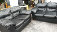Black leather sofa and loveseat delivery available