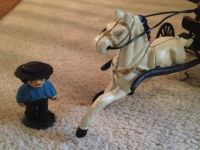 Amish horse and buggy cast iron with figurings