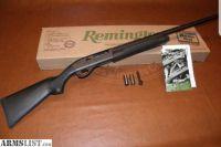 "For Sale: Remington 1100 Competition Semi-Auto Shotgun 25371, 20 Gauge, 26"", 2.75"" Chmbr, Black Synthetic Stock, Blued Finish"