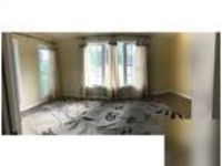 3 BR 2 full BA plus large sunroom. Washer/Dryer Hookup