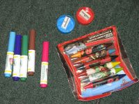 lot of unopened 'Cars' crayons, 'color wonder' markers, and 2 new pencil sharpeners