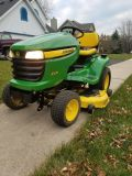 John Deer X320 with Kawasaki Engine.