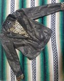 Faux leather jacket with cheetah print inside