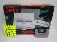 Super Nintendo in box with game