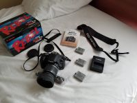 Canon T1i with lens and extra batteries