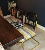 3 bamboo black and brass chairs