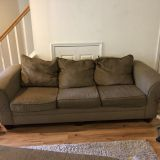 Brown sofa, loveseat and ottoman