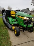 John Deer X300. With Bagger attachment.