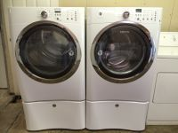 Electrolux Front load Washer and Dryer (electric) w/ pedestals in White