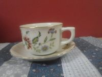 Matching cup and saucer