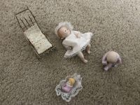 Antique dolls and metal carriage. Dolls are porcelain