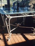 Glass top iron table