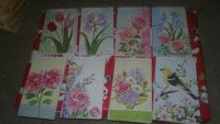 8 floral small spiral bound notebooks. Great stocking stuffers!